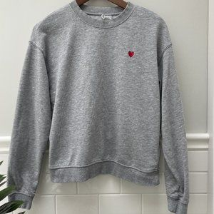 Divided sweatshirt with heart